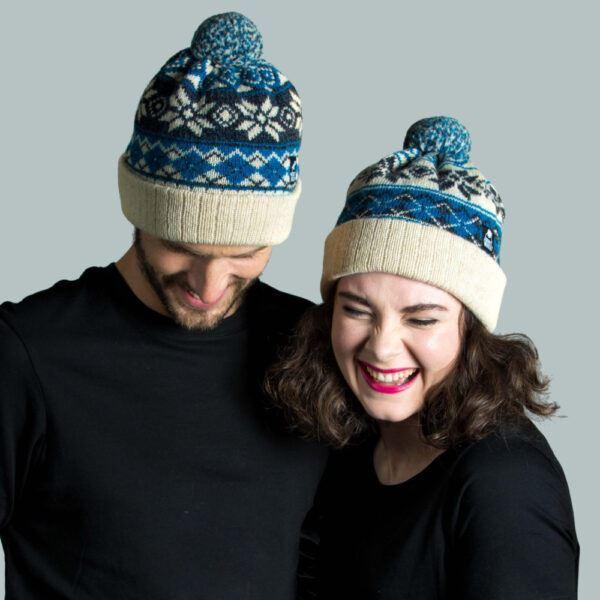 Couple wearing knitted bobble hat in Shetland wool yarn