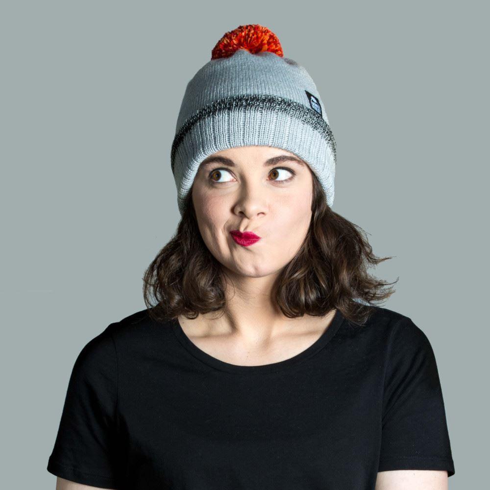 Model wearing merino wool bobble hat