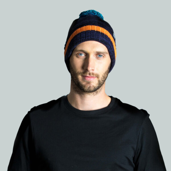 Model wearing bobble hat in merino wool