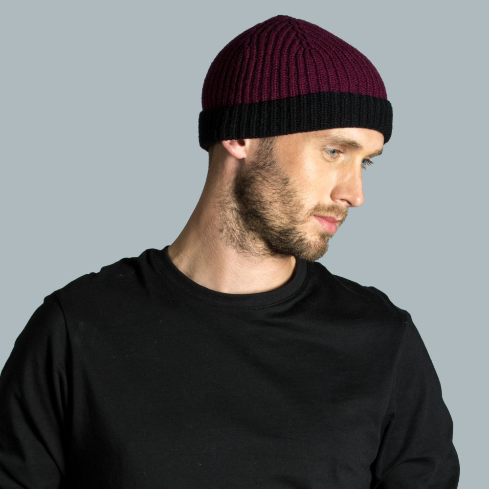 Model wearing knitted lambswool hat