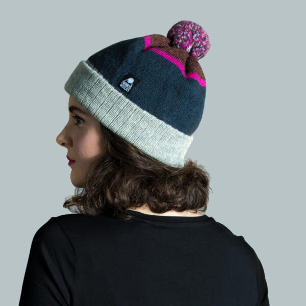 Model wearing hat knitted with Shetland wool yarn