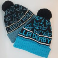 Shetland wool and acrylic yarn versions of this custom bobble hat we made for Leeds Roller Derby.