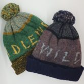 Shetland wool pompom hats with logo knitted in, made for Scottish band Idlewild to promote their 2018 gigs.