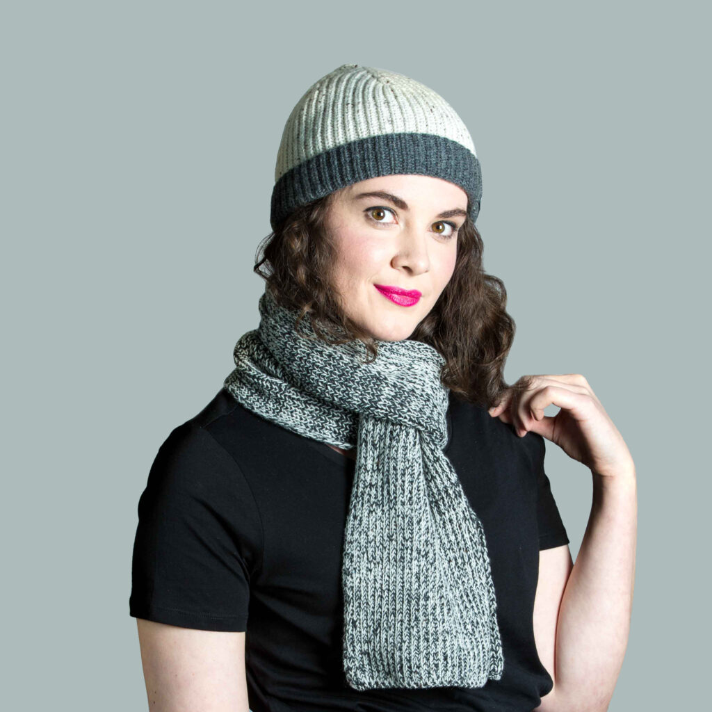 Woman wearing lambswool Spring knitwear hat and scarf.