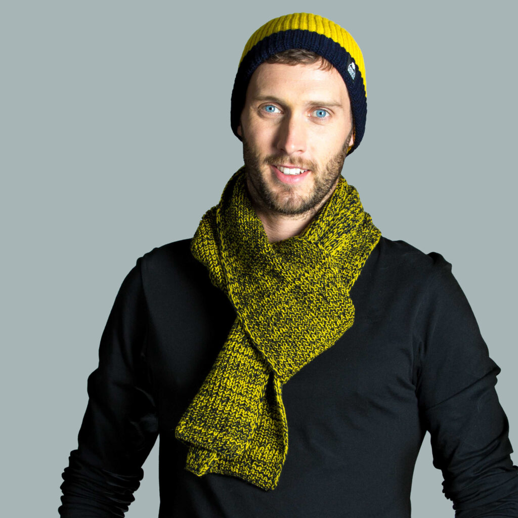 Model wearing a knitted hat and scarf.