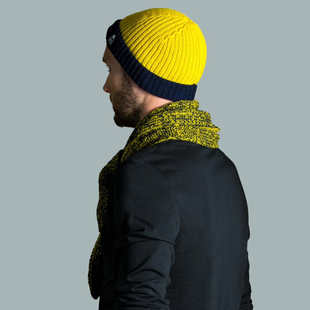 Model wearing lambswool hat and scarf.