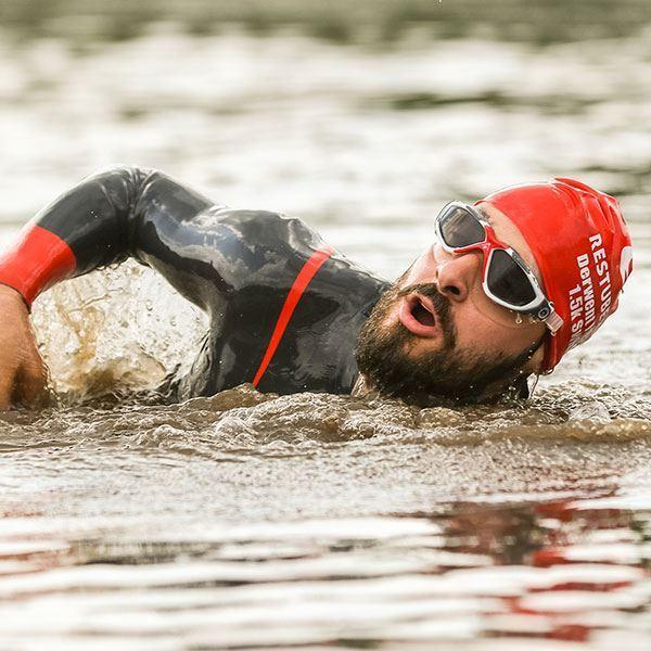 Man swimming in water at Keswick Mountain Festival
