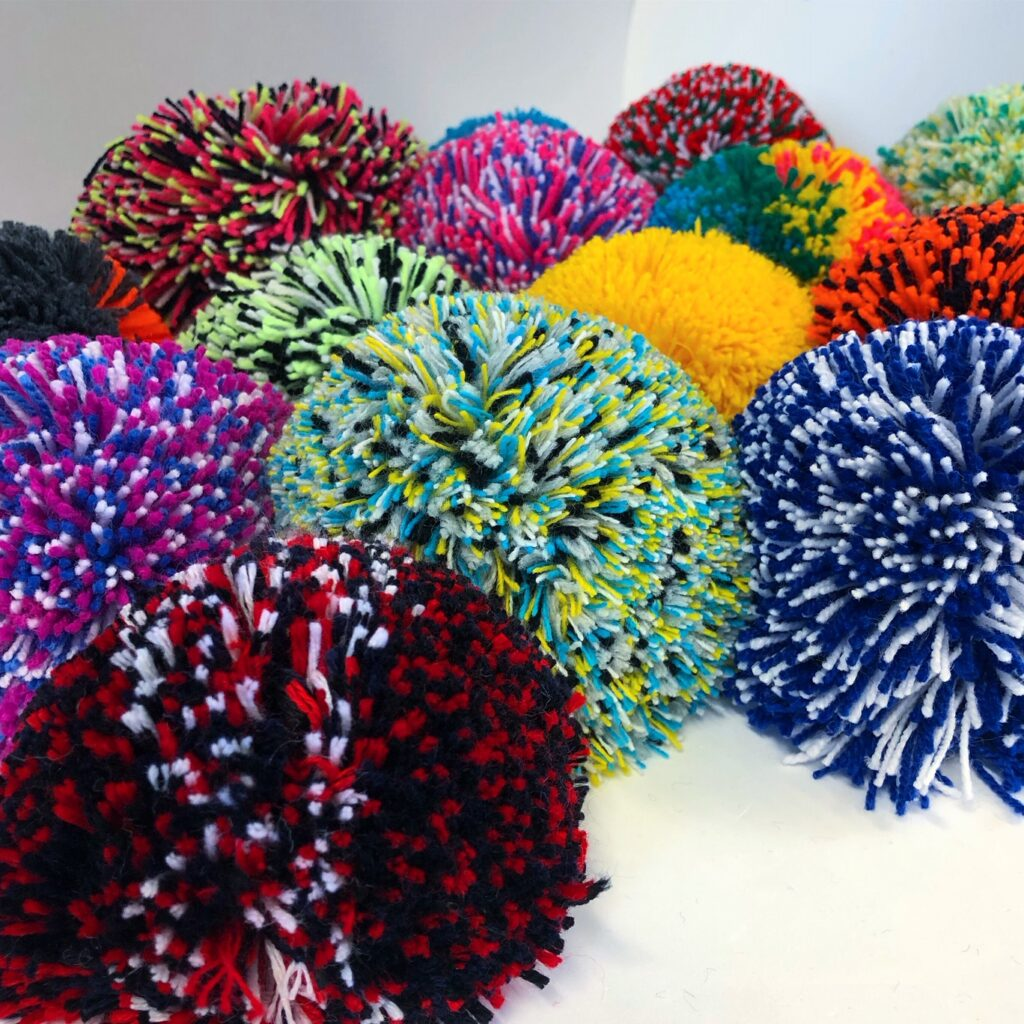 A beautiful bunch of pompoms with different colours and pattern variations